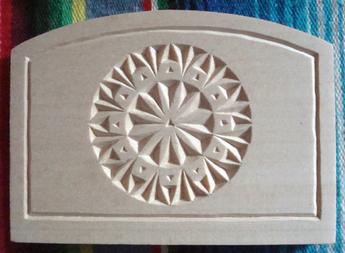 Chip carving napkin holder with rosette design